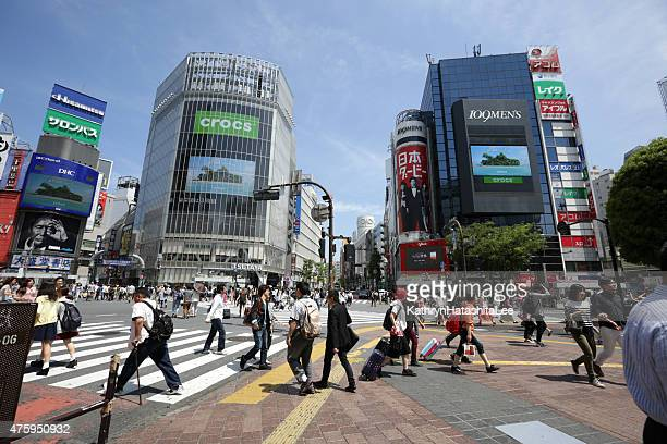 Pedestrians Brave Japan's Busiest Intersection at Shibuya Crossing, Tokyo