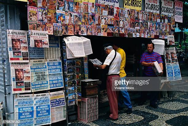 Pedestrians Browsing at a Newsstand