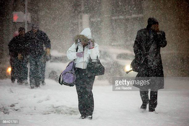 Pedestrians bundle up against the blowing snow December 9 2005 in Boston Massachusetts The snow storm dumped snow throughout the region causing...