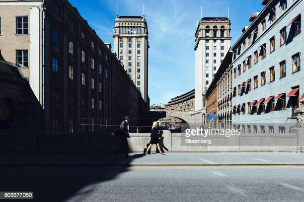 Pedestrians cross a bridge between commercial properties in the Kungsgatan district of central Stockholm Sweden on Wednesday June 28 2017 Just as...