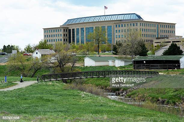 Pedestrians cross a bridge over the High Line Canal just east of the Aurora Municipal Center on May 11 in Aurora Colorado The city of Aurora is...