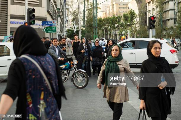 Pedestrians cross a busy street in central Tehran Iran on Sunday Aug 5 2018 Irans central bank acting on the eve of US sanctions scrapped most...