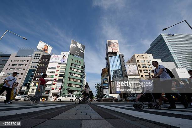 Pedestrians cross a road in the Omotesando area of Tokyo Japan on Monday June 1 2015 Record Japanese property lending is driving such a strong...