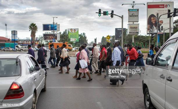 Pedestrians cross a street Street scene in Nairobi capital of Kenya on May 15 2017 in Nairobi Kenya