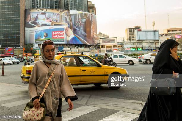 Pedestrians cross an intersection near the Grand Bazaar in Tehran Iran on Sunday Aug 5 2018 Irans central bank acting on the eve of US sanctions...
