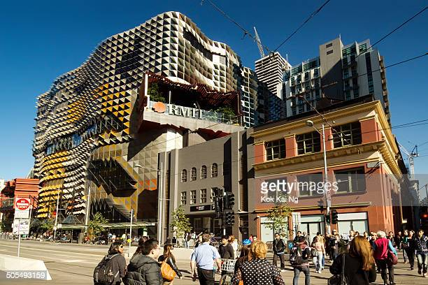 CONTENT] Pedestrians cross an intersection on Swanston Street before RMIT University's new Swanston Academic Building