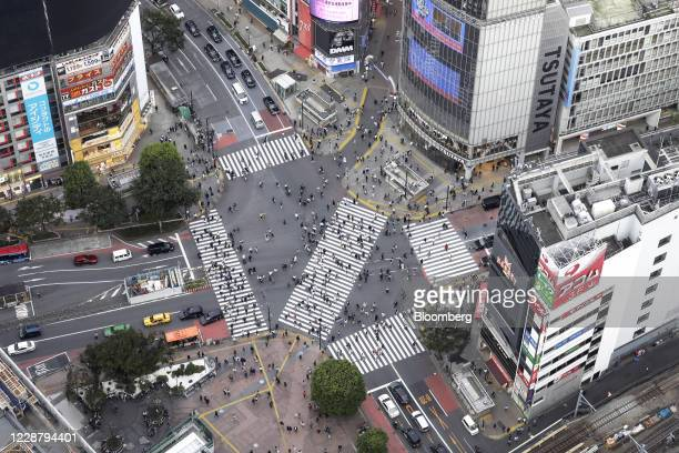 Pedestrians cross an intersection, seen from the Shibuya Sky observation deck of the Shibuya Scramble Square building in Tokyo, Japan, on Tuesday,...