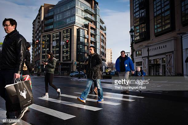 Pedestrians cross Bethesda Avenue at Woodmont Avenue in downtown Bethesda on Saturday December 17 2016 A new land use plan for Bethesda Maryland is...