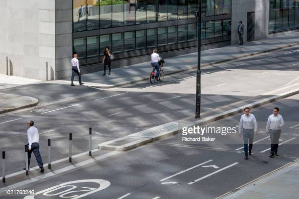 Pedestrians cross London Wall the site of the original Roman walled boundary of their Londinium settlement now known as the City of London the...