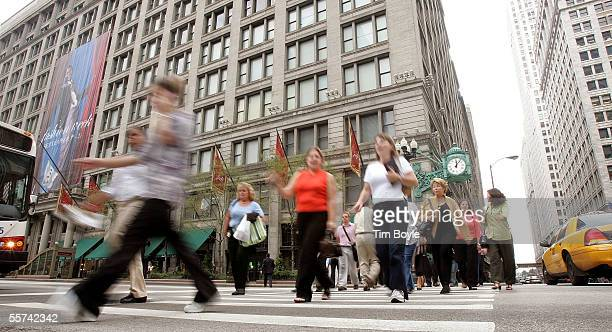 Pedestrians cross State Street in front the onetime flagship Marshall Field's State Street store September 22 2005 in Chicago Illinois The Marshall...