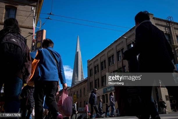 Pedestrians cross Stockton Street ahead of Lunar New Year in the Chinatown neighborhood of San Francisco, California, U.S., on Wednesday, Jan. 22,...