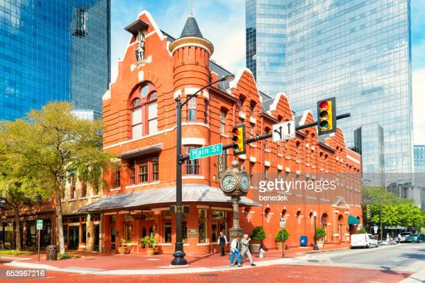 Pedestrians cross street at Sundance Square in downtown Fort Worth Texas USA