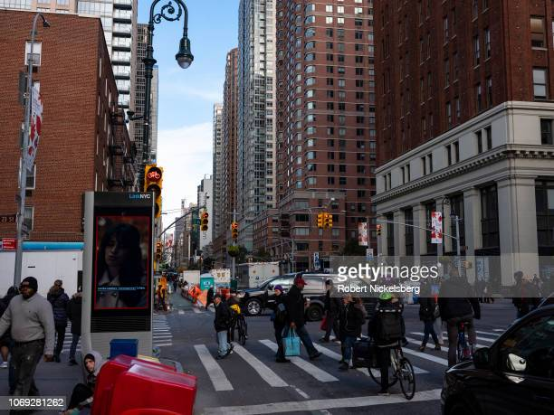 Pedestrians cross streets at a wide intersection in midtown New York City, New York, November 14, 2018.