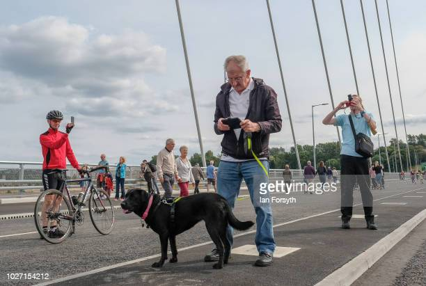 Pedestrians cross the new Northern Spire bridge spanning the River Wear as it opens for a pedestrian walkover on August 28 2018 in Sunderland England...