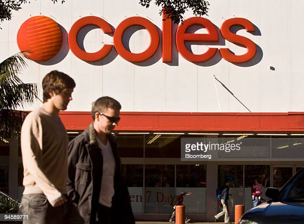 Pedestrians cross the road in front of a Coles Group Ltd supermarket in Sydney Australia on Saturday July 7 2007 Wesfarmers Ltd whose takeover of...