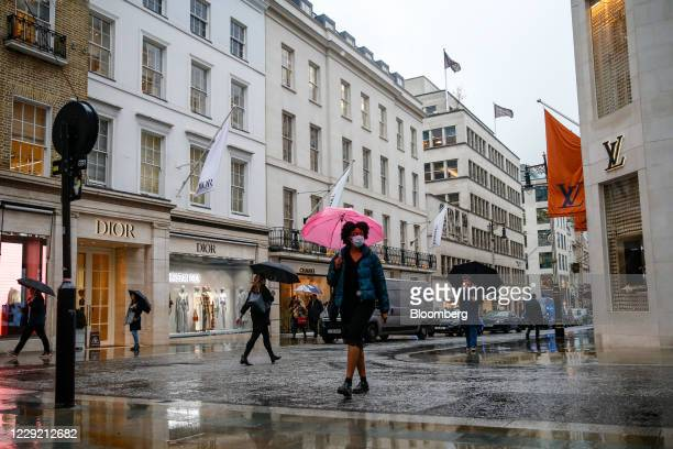 Pedestrians cross the road in view of luxury goods store at New Bond Street in London, U.K., on Wednesday, Oct. 21, 2020. Prices rose 0.5% in...