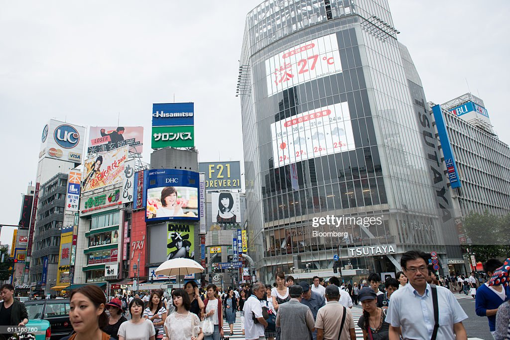 Pedestrians cross the Shibuya crossing in front of the Shibuya Tsutaya media store in the Shibuya district of Tokyo, Japan, on Wednesday, Sept. 28, 2016. Spotify Ltd. is bringing its popular online music service to Japan, a large and lucrative market where fans have demonstrated a continuing fondness for CDs and even vinyl records. Photographer: Noriko Hayashi/Bloomberg via Getty Images