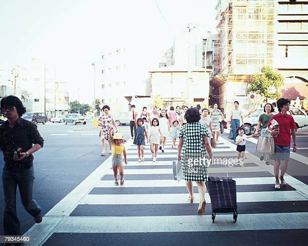pedestrians crossing a zebra zone - showa period stock pictures, royalty-free photos & images