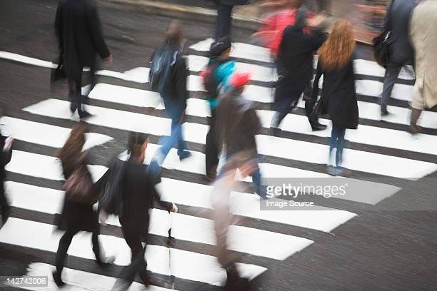 pedestrians crossing road - pedestrian stock pictures, royalty-free photos & images