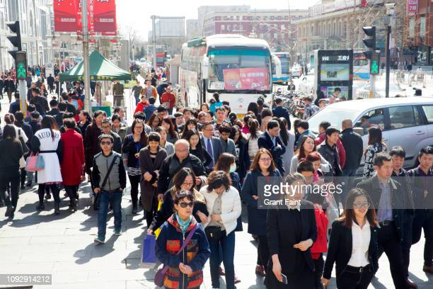 pedestrians crossing street - beijing stock pictures, royalty-free photos & images