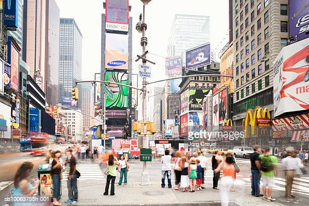 pedestrians crossing street - times square manhattan stock pictures, royalty-free photos & images