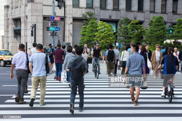 Pedestrians Crossing the Street in Downtown Tokyo, Japan