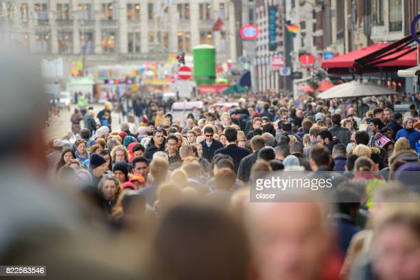 pedestrians crowd on sidewalk in amsterdam - pedestrian zone stock pictures, royalty-free photos & images