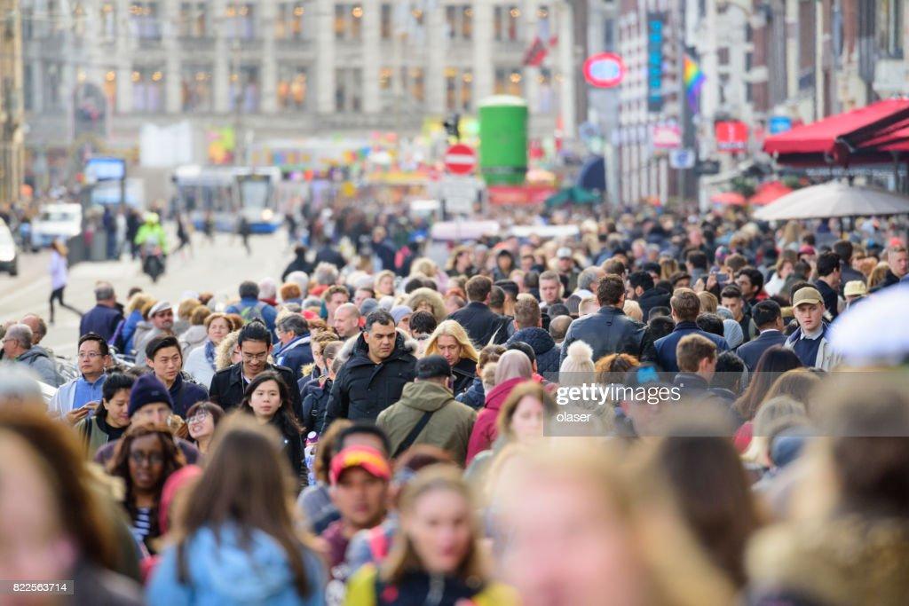 Pedestrians crowd on sidewalk in amsterdam : Stock Photo