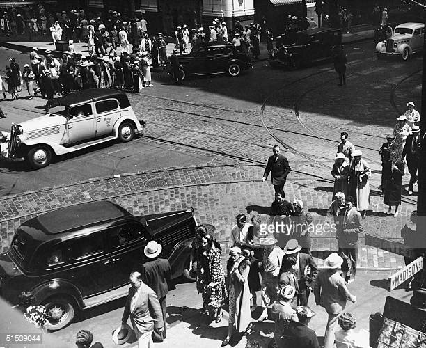 Pedestrians crowd the intersection of State and Madison streets Chicago Illinois early 1930s