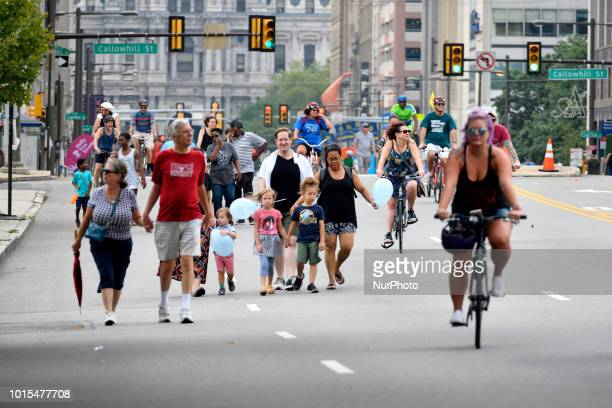 Pedestrians cyclist skaters joggers enjoy a closed off 4mi section of North Broad Street in Philadelphia PA during the third annual Philly Free...