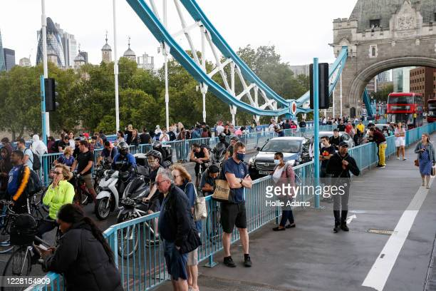 Pedestrians, cyclists and traffic stuck on Tower Bridge on August 22, 2020 in London, England. Tower Bridge was closed this afternoon to due a...