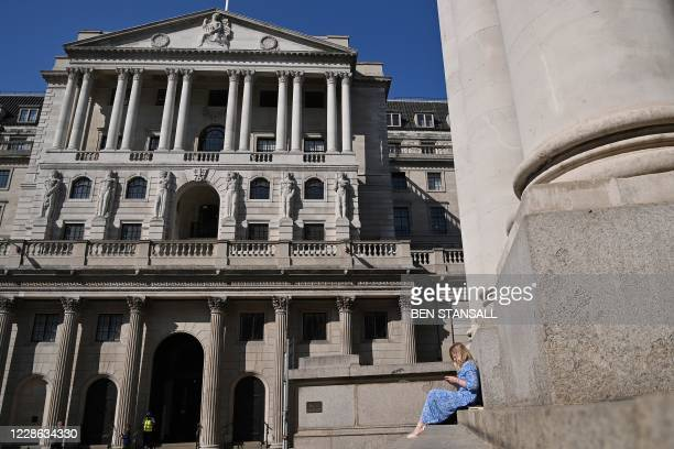 Pedestrians enjoy the sunlight by the Bank of England in central London on September 21 2020 England is on track for about 50000 coronavirus cases a...