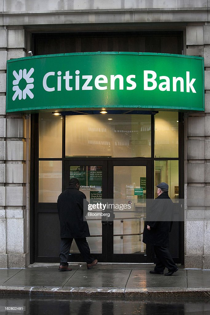 Pedestrians enter a Citizens Financial Group Inc. bank branch in Boston, Massachusetts, U.S., on Wednesday, Feb. 27, 2013. Royal Bank of Scotland Group Plc will this week announce plans to sell a stake in Citizens Financial Group Inc. and shrink assets at its investment-bank by as much as 30 billion pounds, said a person with knowledge of the plans, who asked not to be identified because the matter is private. Photographer: Kelvin Ma/Bloomberg via Getty Images