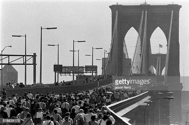 Pedestrians flee Manhattan by walking across the Brooklyn Bridge The World Trade Center in New York City was the target of a terrorist attack Two...