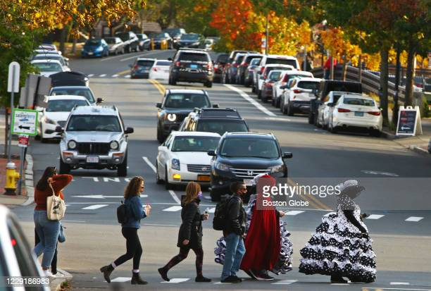 Pedestrians in costume and normal dress cross the street in Salem, MA on Oct. 18, 2020. The mayor has asked people to not come to the city on...