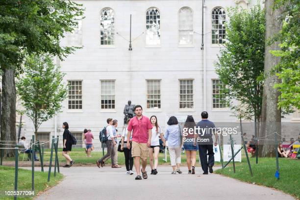 Pedestrians in Harvard Yard at Harvard University building on August 30 2018 in Cambridge Massachusetts The US Justice Department sided with...