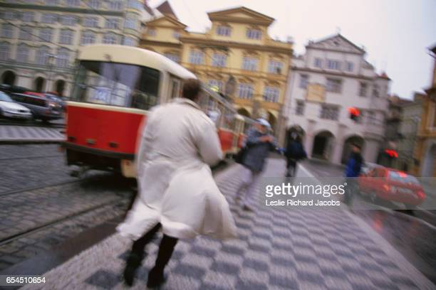 pedestrians in prague - vintage raincoat stock photos and pictures
