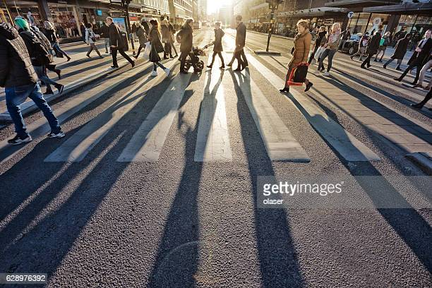 pedestrians in silhouette, sunset in stockholm - pedestrian stock pictures, royalty-free photos & images