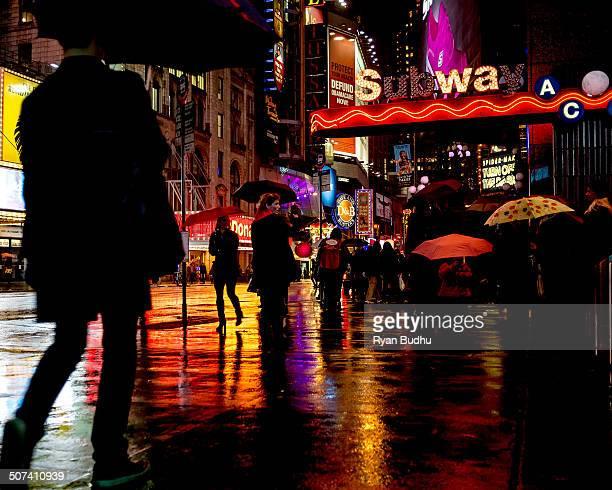 CONTENT] Pedestrians in Times Square in the rain