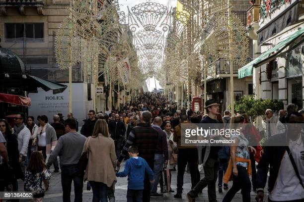 Pedestrians in Trik IrRepubblika on December 8 2017 in Valletta Malta Valletta a fortified town that dates back to the 16th century is the...