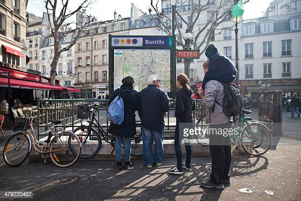 Pedestrians look at a map of the city in Bastille square in Paris France on Friday March 14 2014 Air Parif an association that tracks air quality...