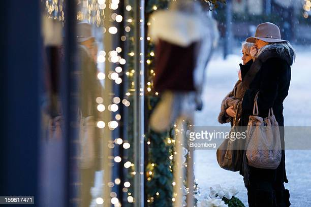 Pedestrians look in the window of a fashion store in Gstaad Switzerland on Saturday Jan 19 2013 Options traders are pushing the cost of bearish...