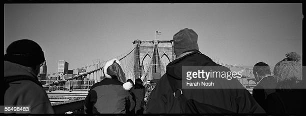 Pedestrians make their way across the Brooklyn Bridge December 20 2005 in New York City The city's first transit strike in 25 years forced commuters...
