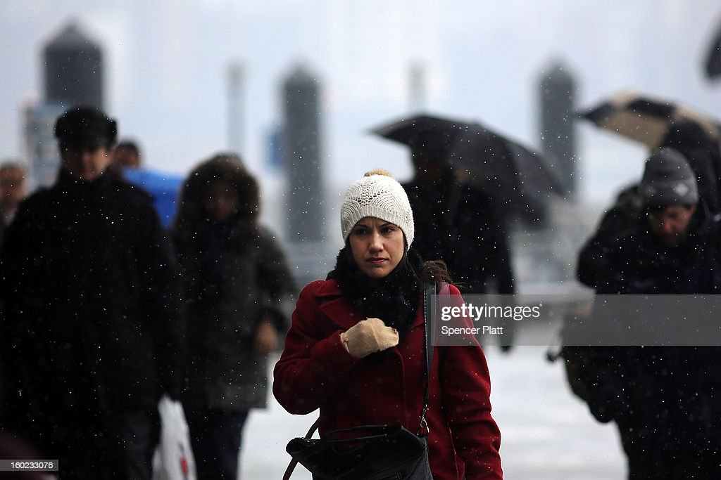 Pedestrians make their way through the snow during the morning commute on January 28, 2013 in New York City. Following some of the coldest weather this winter, temperatures are expected to gradually warm during the week in New York.