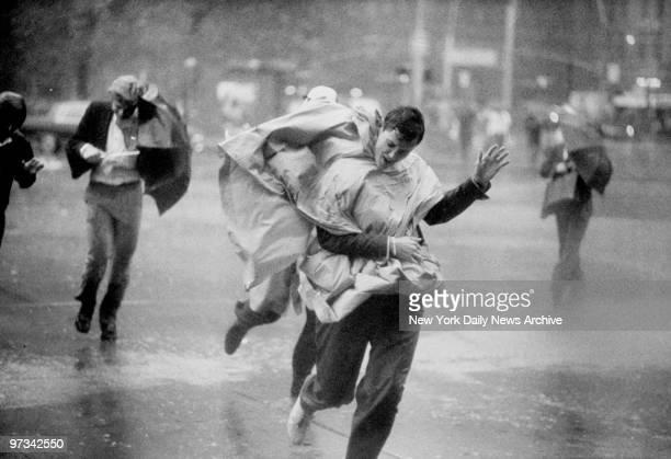 Pedestrians making their way along South Street during Hurricane Gloria.
