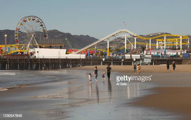 Pedestrians Monday morning enjoy the beautiful weather along the Santa Monica beach which remains open at all times. But out of an abundance of...