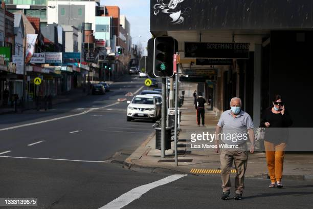 Pedestrians move along High Street wearing face masks in Penrith on August 09, 2021 in Sydney, Australia. Restrictions for the suburbs of Penrith...