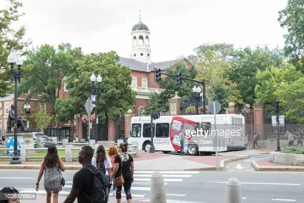 Pedestrians near the gate to Harvard Yard at Harvard University on August 30 2018 in Cambridge Massachusetts The US Justice Department sided with...