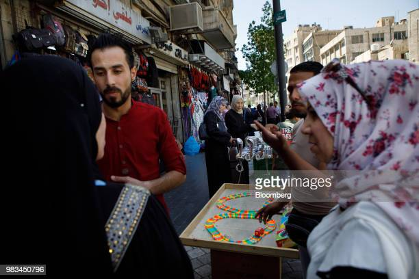 Pedestrians negotiate with street vendors in Amman Jordan on Thursday June 21 2018 President Trump and First Lady Melania Trump will host...