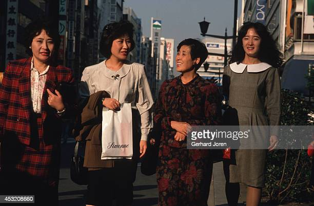 Pedestrians on a main street in the shopping district in Ginza Tokyo